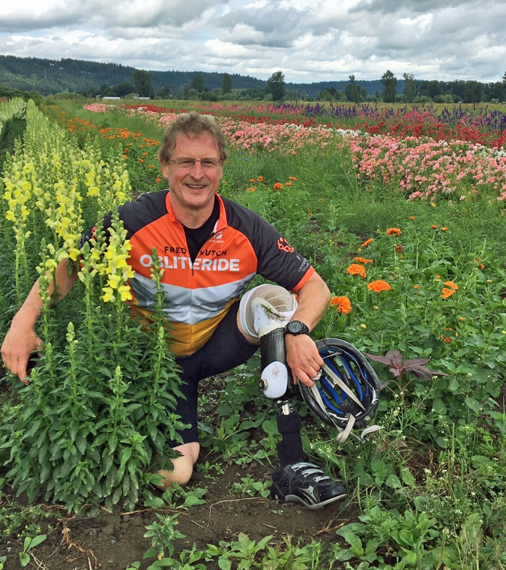 David biking and flower field